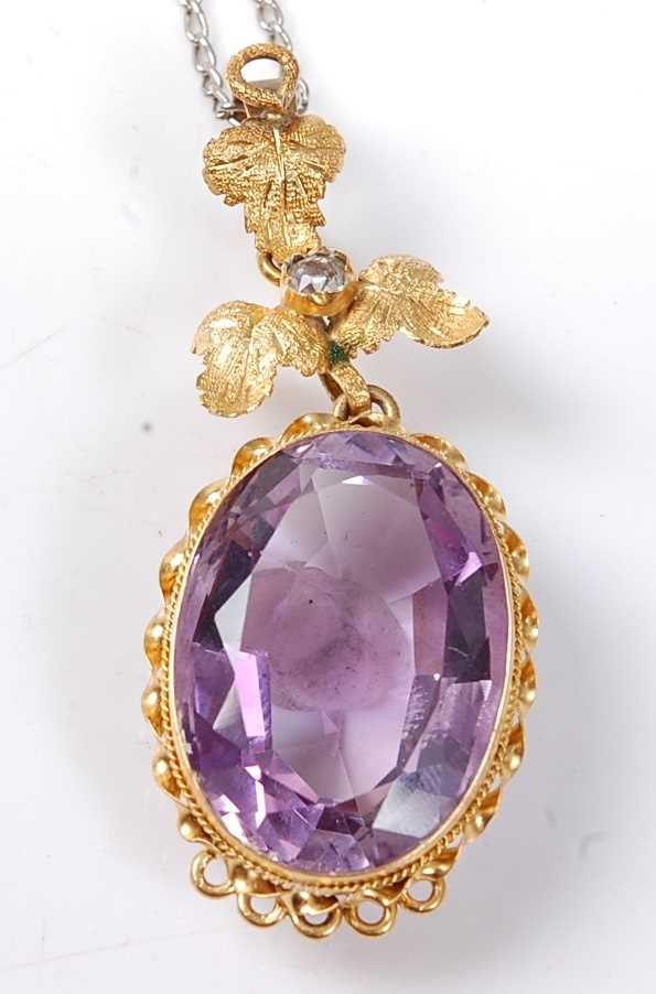 Lot 2526 - A yellow metal Etruscan style amethyst pendant,...
