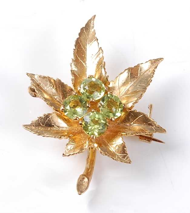 Lot 2524 - A 9ct yellow gold Maple leaf brooch, having a...