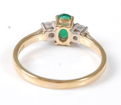 Lot 2522 - An 18ct yellow and white gold, emerald and...