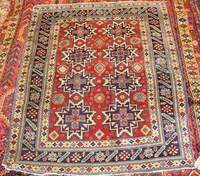 Lot 1 - * A Turkish woollen rug, the red ground...