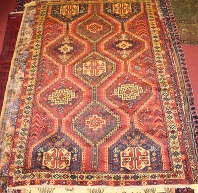 Lot 2 - * An Afghan woollen Shirvan rug, the red...