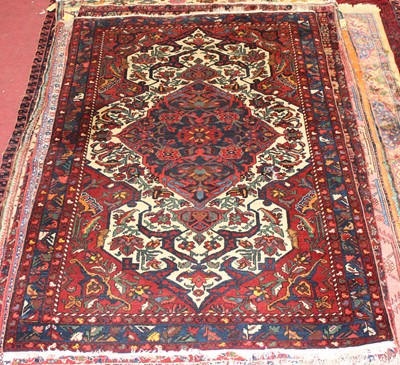 Lot 4 - * A Persian woollen Herat rug, the red ground...