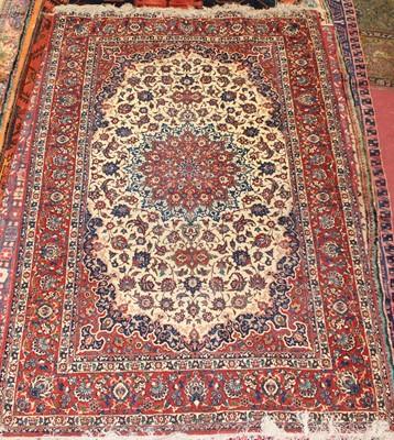Lot A Persian woollen Tabriz rug, the cream ground...