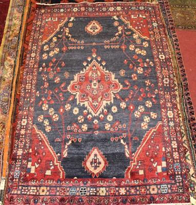 Lot 7 - * A Persian woollen rug, having a deep pile,...