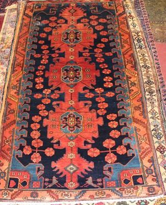 Lot 8 - * A Persian woollen Kazak rug, the blue ground...