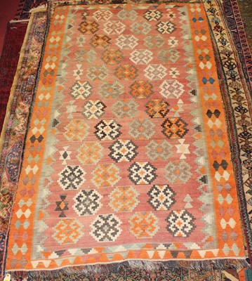 Lot 9 - * A Turkish woollen Kilim rug, the faded red...