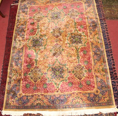 Lot 11 - * An Indo-Persian woollen rug, the beige...