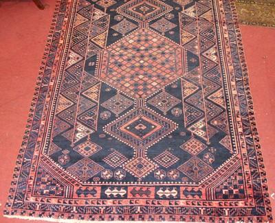 Lot 12 - * A Turkish woollen rug, the blue ground...