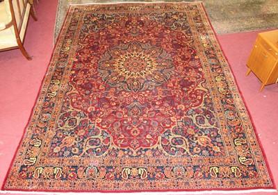 Lot 13 - * A Persian woollen Tabriz style carpet, the...