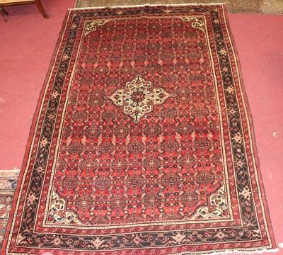 Lot 14 - * A Persian woollen Hamadan rug, the red...
