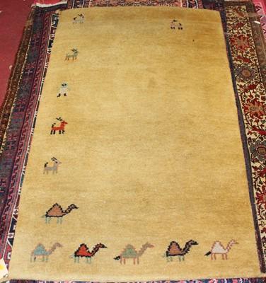 Lot 15 - * An Afghan woollen rug, having a deep pile,...