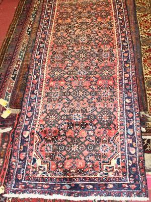 Lot 16 - * A Persian woollen Hamadan hall runner, the...