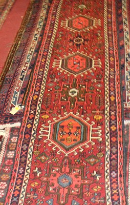 Lot 17 - * A Turkish woollen hall runner, the red...