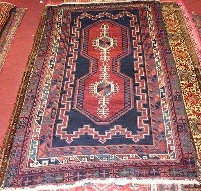Lot 18 - * A Persian woollen Kazak rug, the deep blue...