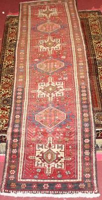 Lot 19 - * A Turkish woollen hall runner, the red...