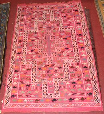 Lot 21 - * A Turkish woollen Kilim rug, the pink ground...