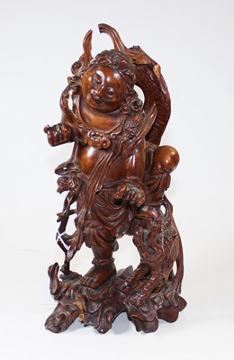 Lot 7 - An early 20th century carved wood figure of a...