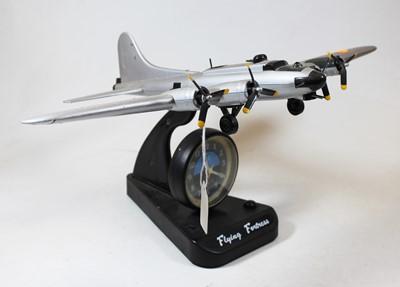 Lot 10 - An ASA Flying Fortress quartz alarm clock, in...