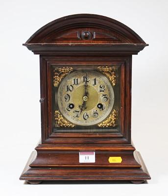 Lot 11 - A late 19th century oak cased mantel clock,...