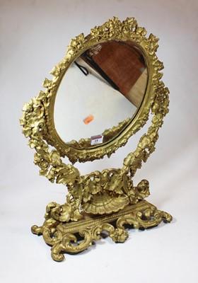 Lot 15 - A 19th century gilt metal swing framed...