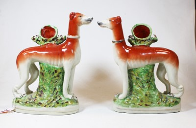 Lot 19 - A pair of reproduction Staffordshire pottery...