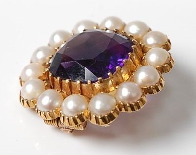 Lot 2546 - A yellow metal, amethyst and seed pearl...