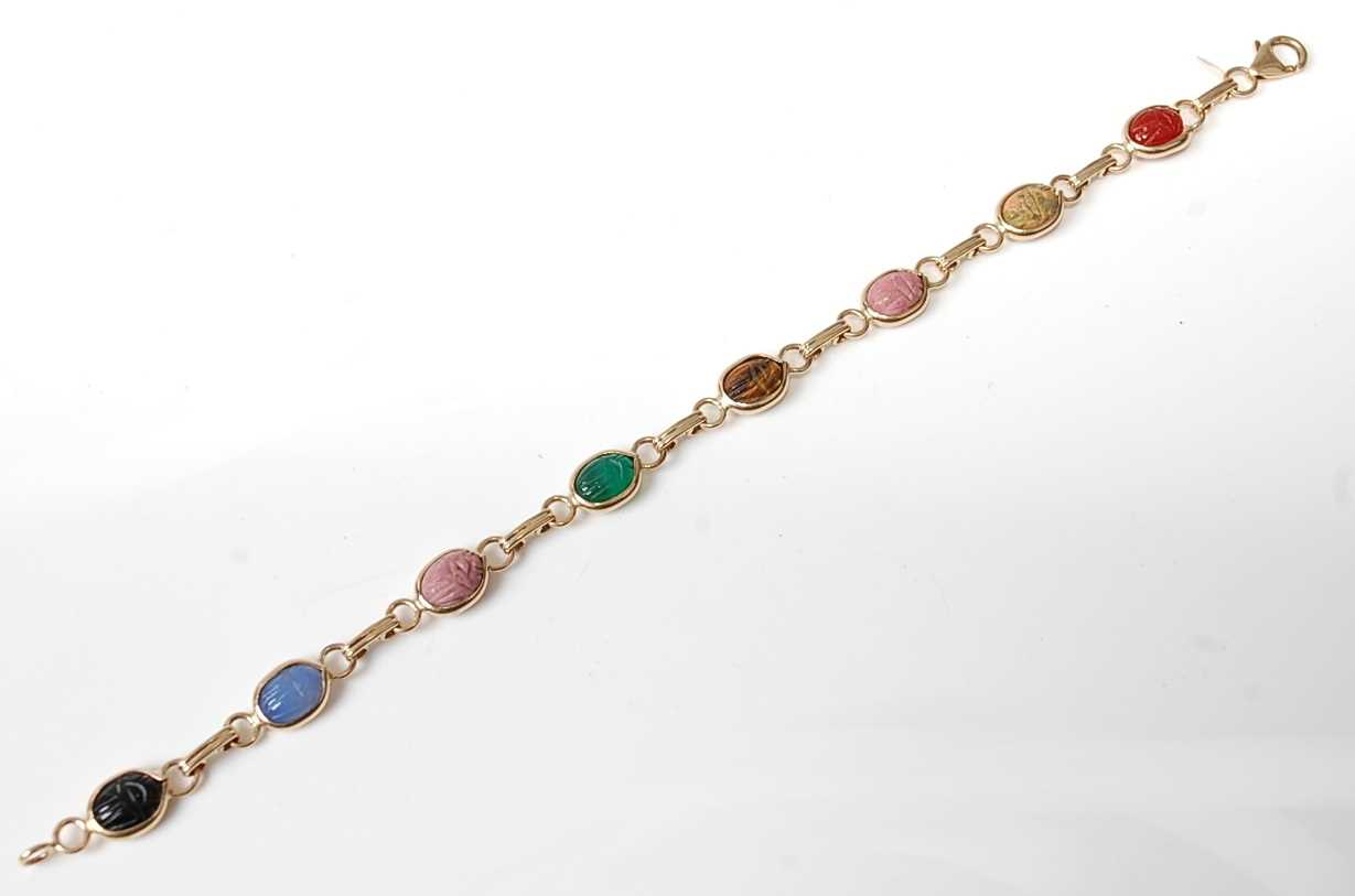 Lot 2547 - A yellow metal multi-stone bracelet, featuring...