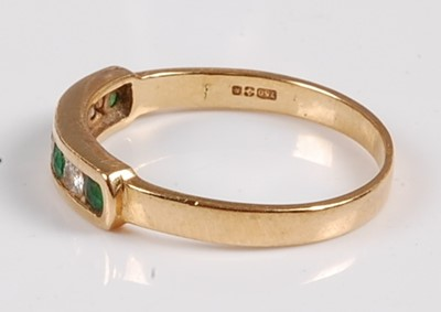 Lot 2552 - An 18ct yellow gold, emerald and diamond seven...