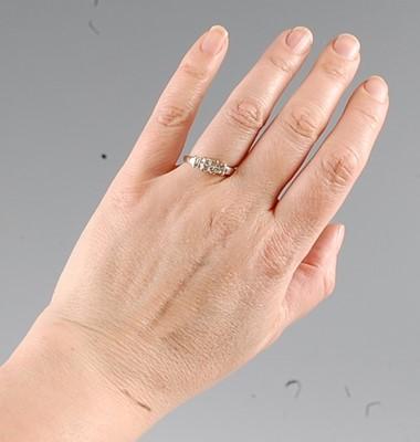Lot 2562 - A white metal diamond dress ring, comprising...