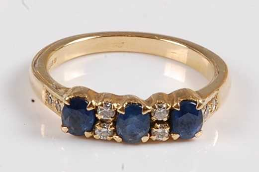 Lot 2549 - An 18ct yellow gold, sapphire and diamond half...