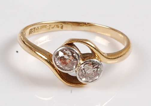 Lot 2559 - A yellow and white metal diamond two-stone...