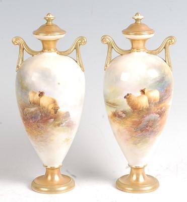 Lot 1015 - A pair of Royal Worcester porcelain pedestal...