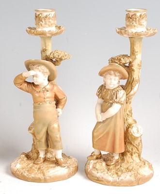 Lot 1027 - A pair of Hadley Worcester porcelain boy and...