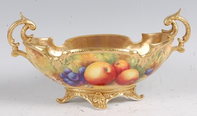 Lot 1022 - A Royal Worcester twin handled footed...