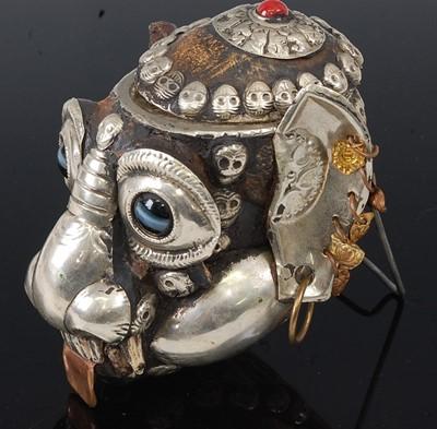 Lot A Tibetan white metal mounted monkey skull...