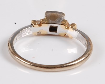 Lot 2558 - An 18ct white and yellow gold, diamond single...