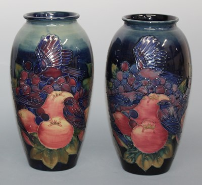 Lot 13 - A pair of modern Moorcroft pottery vases in...