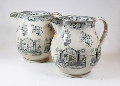 Lot 5 - A pair of early 19th century jugs, each...