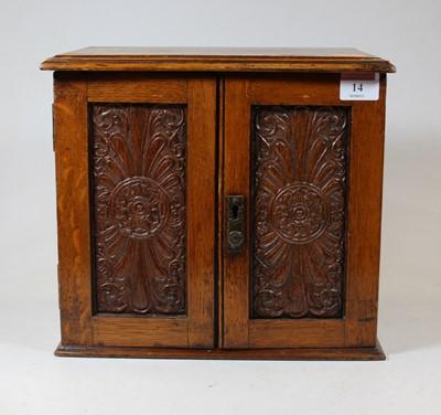 Lot 14 - An Edwardian oak smokers cabinet, having a...