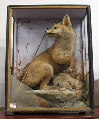 Lot 18 - A Victorian taxidermy model of a fox with prey,...