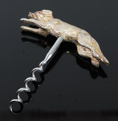 Lot A contemporary silver corkscrew, the handle...
