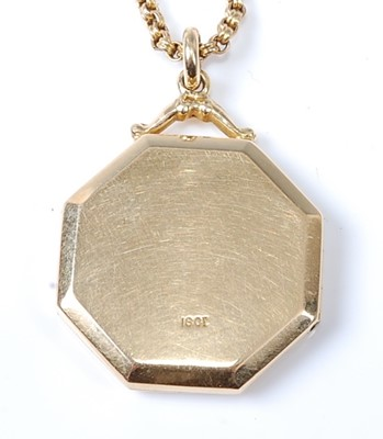 Lot 2570 - A yellow metal octagonal locket with a centre...