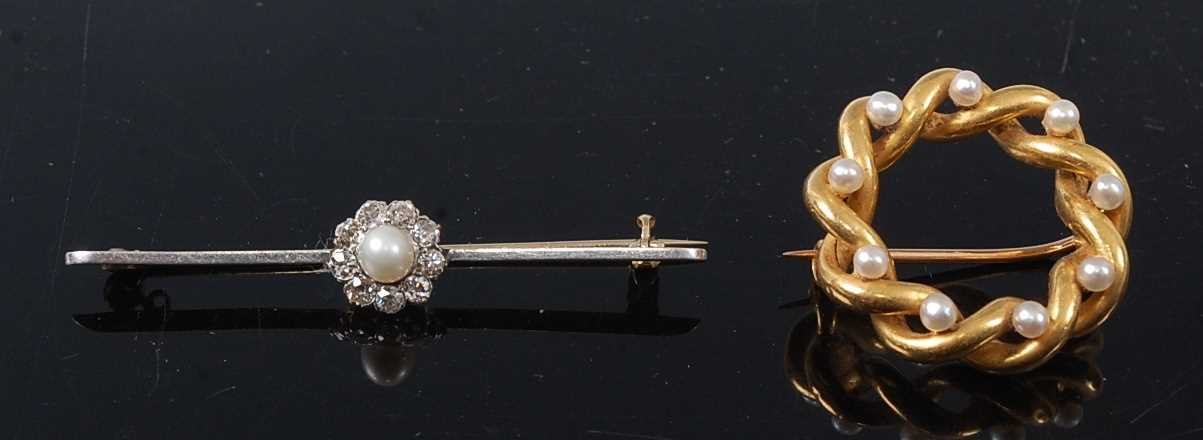 Lot 2572 - Two yellow metal brooches, comprising a...