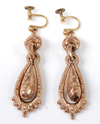 Lot 2573 - A pair of rose metal hollow articulated ear...
