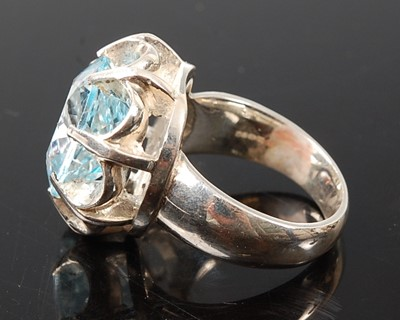 Lot 2574 - A white metal blue topaz single stone ring,...