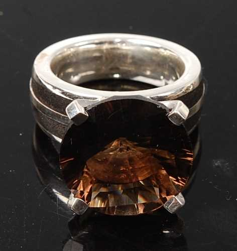 Lot 2575 - A sterling silver smoky quartz dress ring,...