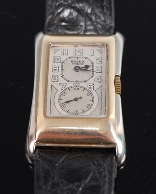 Lot 1239 - A vintage gent's 9ct yellow and white gold...