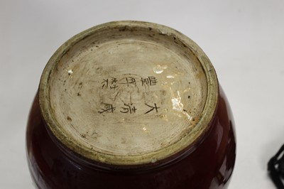 Lot 12 - A large Chinese red flambe glazed stoneware...
