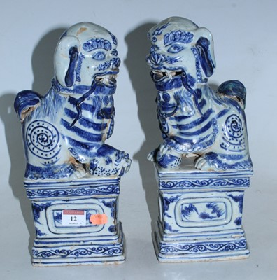 Lot 12 - A pair of reproduction blue & white glazed...