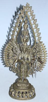 Lot 18 - An Indian brass model of a Hindu deity in...